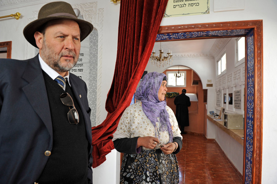 M. Jacky Kadoch and Aisha, the Berber keeper of the shrine of the great Jewish saint Rabbi David u-Moshe (16th century) with keys in hands. The shrine is visited by both Jews and Muslims, Agoïm, 2012