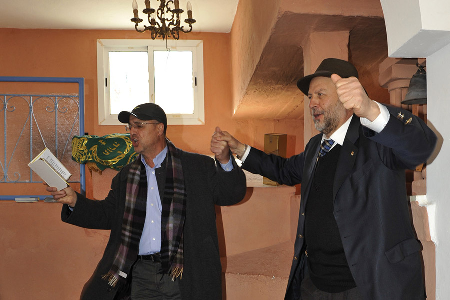 Mr. Jacky Kadoch and a pilgrim from Chicago singing Psalms before the tomb of the great saint Rabbi David u-Moshe (16th century), village of Agoïm, 2012