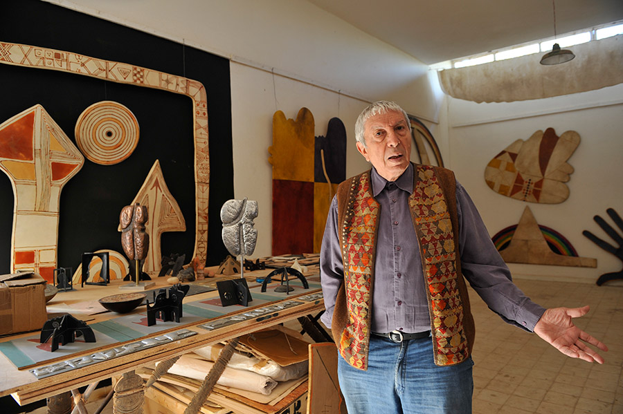 The artist Farid Belkahia stands in front of his project of urban sculptures honoring the seven protector saints of Marrakech, 2012