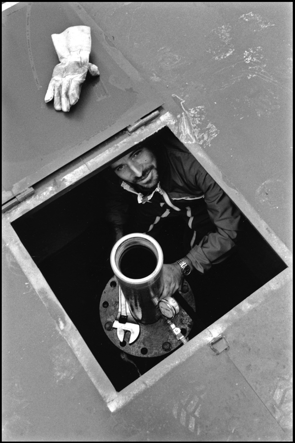 Engineer preparing scientific measurements in a borehole.
