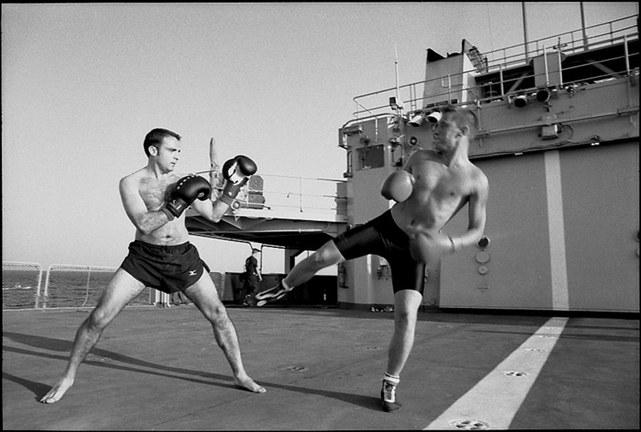 Two officers of Task Force 150 practice boxing