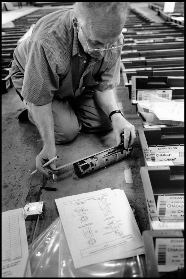 Geologist measuring a granite core sample.