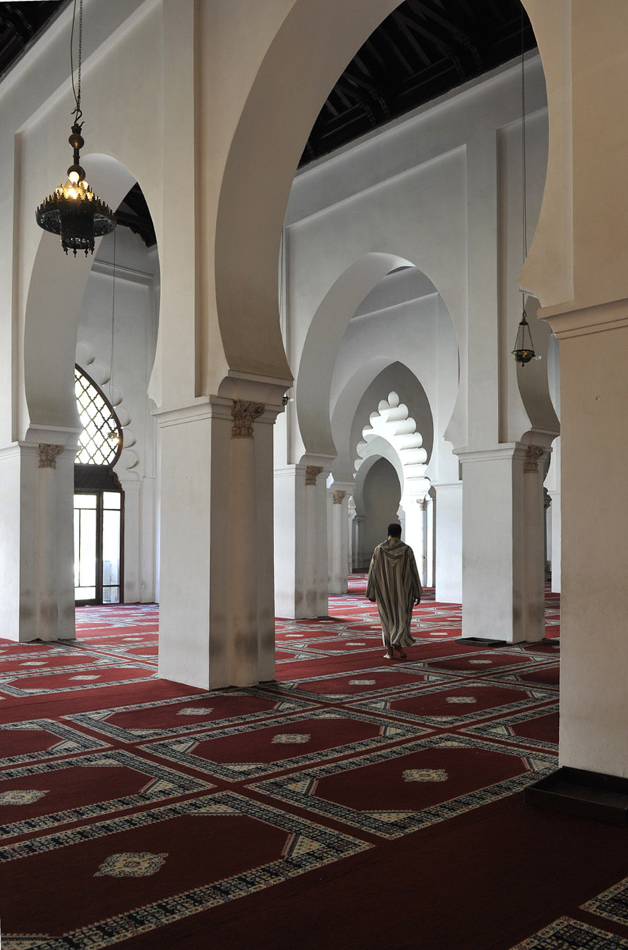 The Muezzin of the Koutoubia walking towards the minaret to issue the call to prayer, Marrakech, 2011