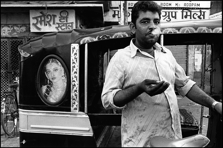 Image of Bollywood star, Rekha, on an autorickshaw and a passerby, Jodhpur, Rajasthan, 1988