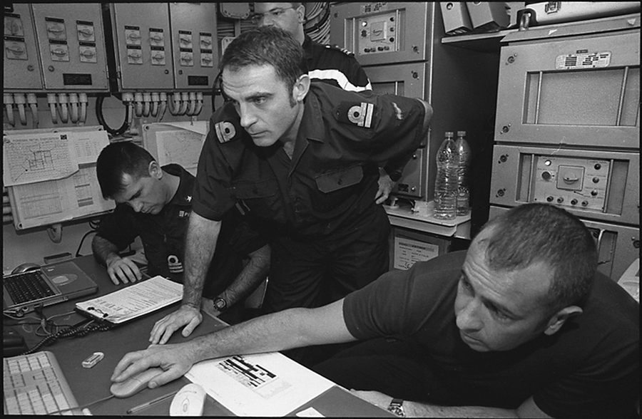 Portuguese, Italian and Spanish TF 150 officers in the telecommunications room