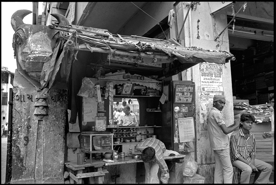 Betel nut stall and ear cleaner, Bombay, 1988